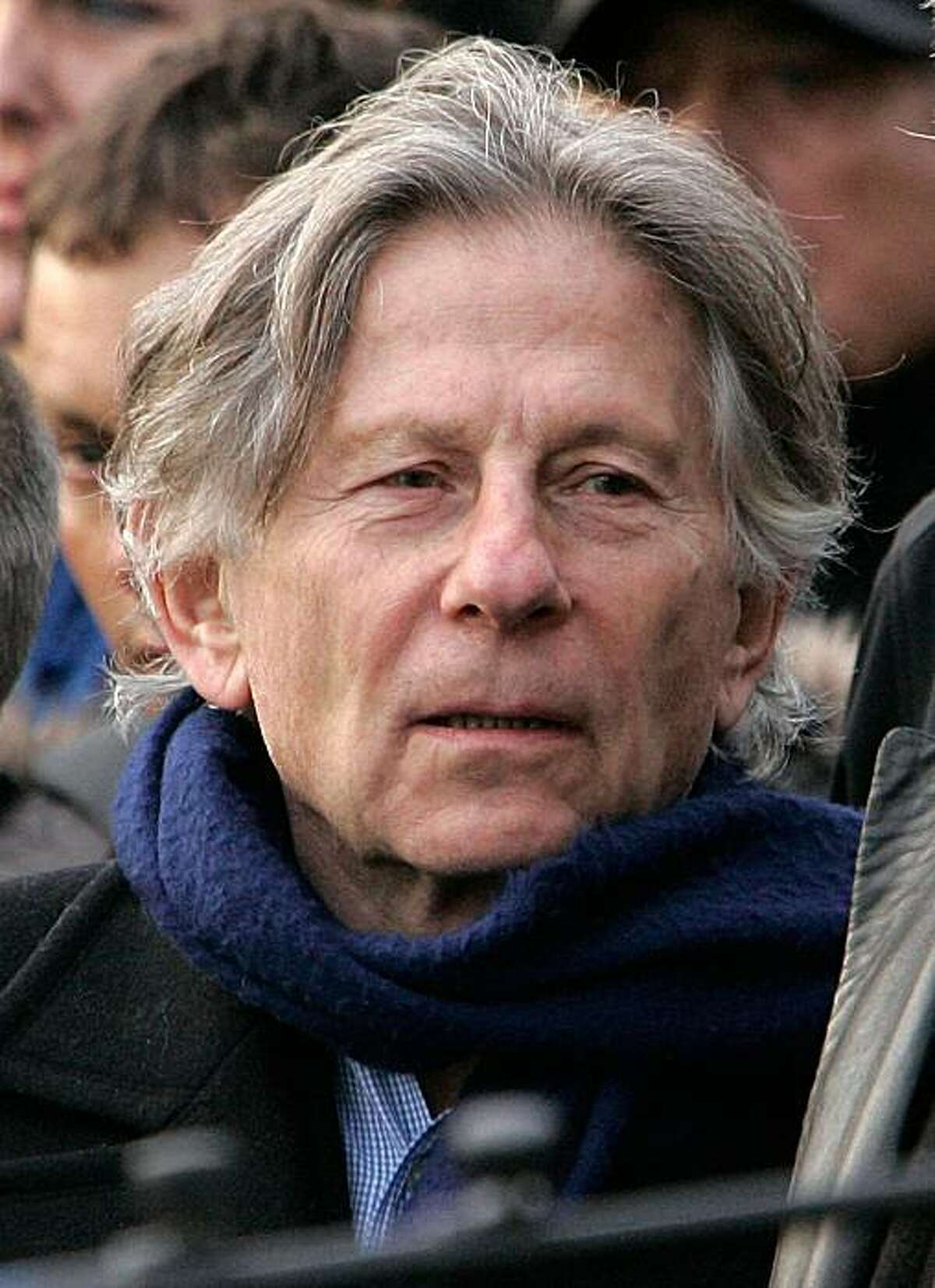 """Film director Roman Polanski in Montrouge, France. Lawyers for the """"Chinatown"""" director Polanski said Tuesday Jan 12, 2010 that a December 2009 photo and many others invaded his privacy as well as his family's, and he and his wife are suing four French publications, two newspapers and two magazines, for a total of about $217,000 dollars."""