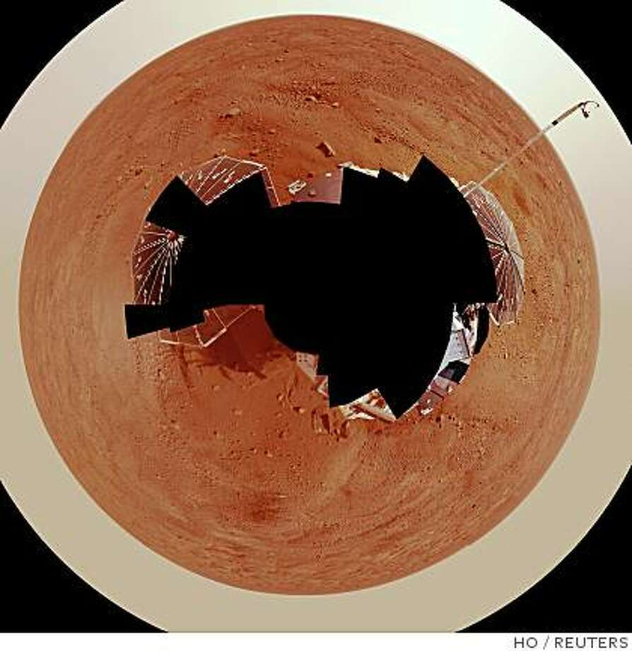 A full circle panoramic view of Mars taken by NASA's Phoenix Mars Lander is shown in this undated handout photo released to Reuters July 31, 2008. NASA scientists said on Thursday they had definitive proof that water exists on Mars after further tests on ice found on the planet in June by the Phoenix Mars Lander.     REUTERS/NASA/JPL-Caltech/University Arizona/Texas A&M University/Handout.  FOR EDITORIAL USE ONLY. NOT FOR SALE FOR MARKETING OR ADVERTISING CAMPAIGNS. Photo: HO, REUTERS