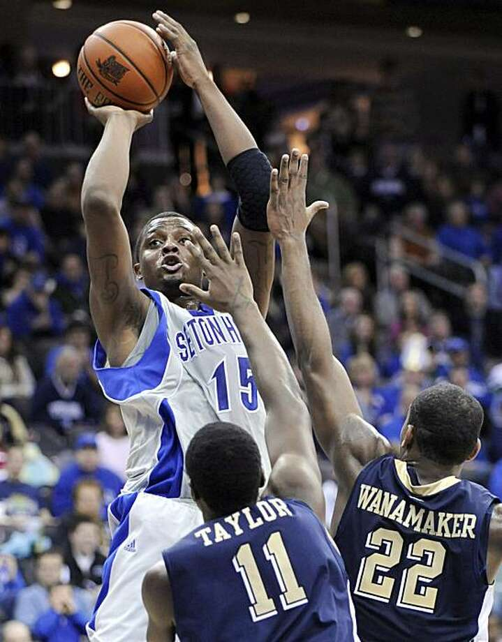 Seton Hall's Herb Pope (15) shoots over the defense of Pittsburgh's Dante Taylor (11) and Brad Wanamaker (22) during the first half of an NCAA college basketball game Sunday, Jan. 24, 2010, in Newark, N.J. Pope led Seton Hall with 19 points as they defeated Pittsburgh 64-61. Photo: Bill Kostroun, AP
