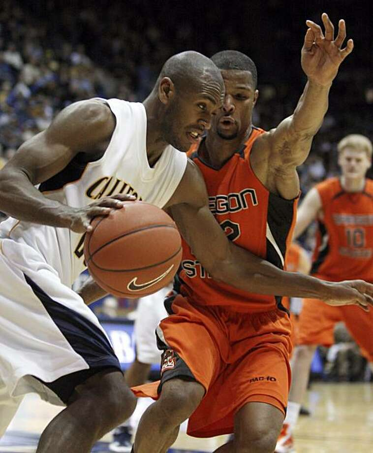 California's Patrick Christopher, left, drives against Oregon State's Calvin Haynes during the second half Saturday in Berkeley. Photo: Ben Margot, AP