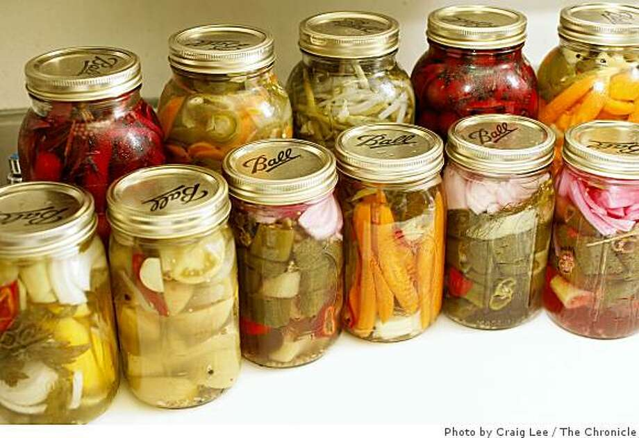 Several jars of pickled fruits and vegetables, such as spicy carrots, cherries, Hungarian peppers, green beans, green tomatoes and carrots and habaneros, made by Erica Holland-Toll, chef at The Lark Creek Inn in Larkspur, Calif. on July 21, 2008. Photo by Craig Lee / The Chronicle Photo: Photo By Craig Lee, The Chronicle