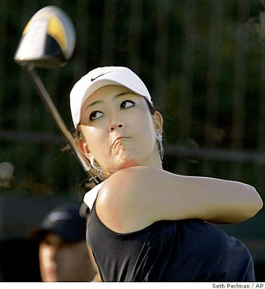 Michelle Wie drives off the number one tee during the first round of the LPGA State Farm Classic 2008 golf tournament in Springfield, Ill., Thursday, July 17, 2008. (AP Photo/Seth Perlman) Photo: Seth Perlman, AP