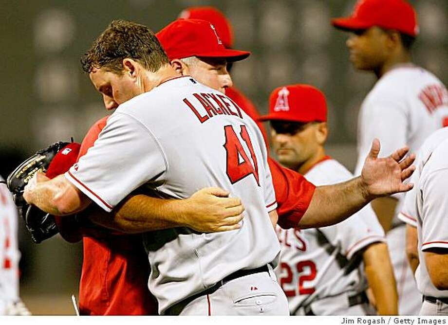 BOSTON - JULY 29: John Lackey #41 of  the Los Angeles Angels of Anaheim is embraced by coach Mike Scioscia after throwing a two-hiiter against the Boston Red Sox at Fenway Park on July 29, 2008 in Boston, Massachusetts.  He allowed his first hit with one out in the ninth inning to Dustin Pedroia #15 of the Boston Red Sox. (Photo by Jim Rogash/Getty Images) Photo: Jim Rogash, Getty Images