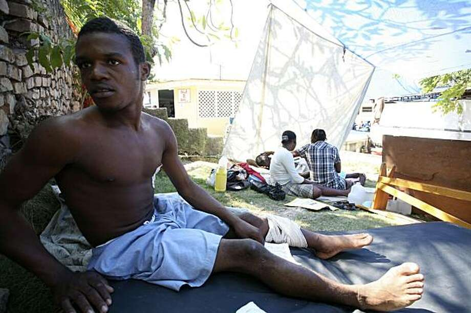 Quake survivor Benito Revolus, 23, who spent five days trapped under the rubble before being saved by an American rescue team, sits on the lawn of the Medecins Sans Frontieres aid group in Port-au-Prince, Haiti, on Wednesday, Jan. 20, 2010. Doctors say itis exceptional for an injured man like Revolus to survive five days underground with no food or water. Photo: Alfred De Montesquiou, AP