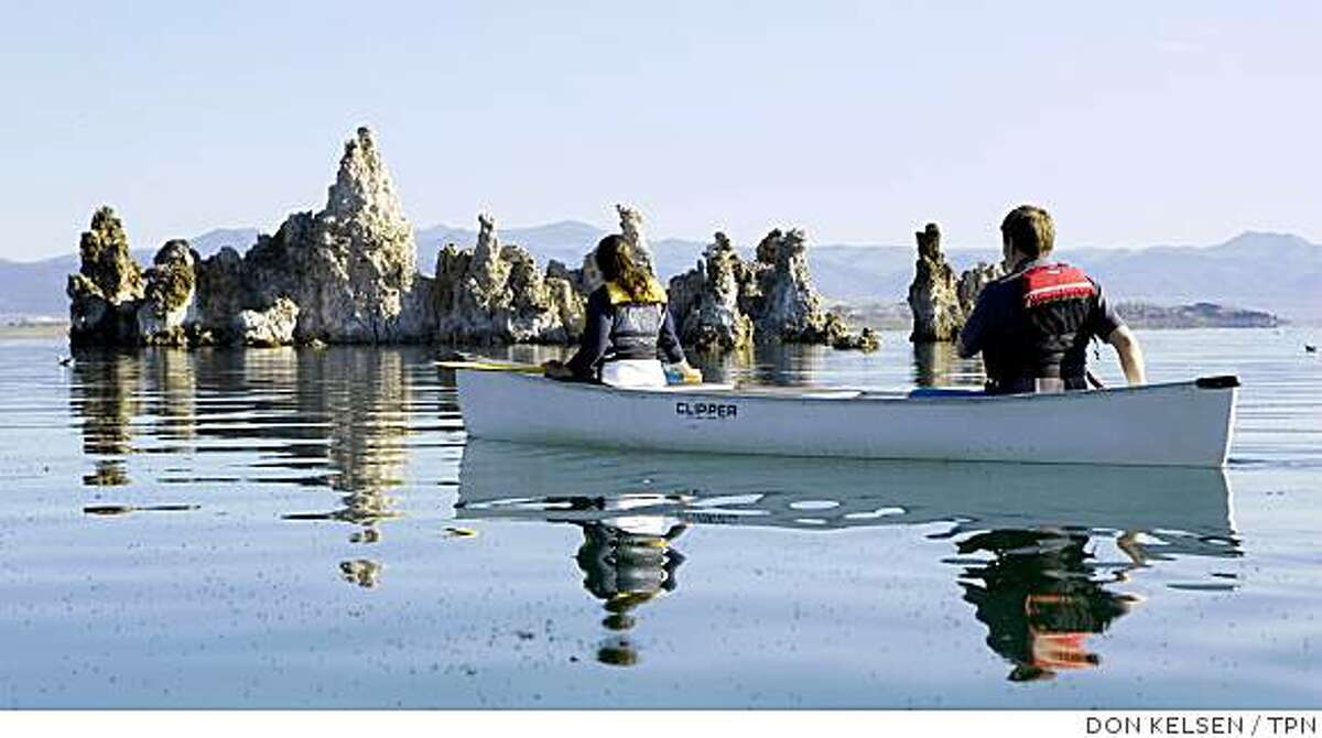 Outdoor instructor Becky Clough and Geoffrey McQuilkin, executive director of the Mono Lake Committee, canoe near the tufa formations. Illustrates CALIF-MONOLAKE (category a) by Louis Sahagun (c) 2008, Los Angeles Times. Moved Monday, July 28, 2008. (MUST CREDIT: Los Angeles Times photo by Don Kelsen.)