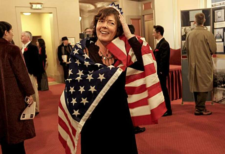 New citizen, Caroline Diericx, an immigrant of Belgium, checks her tiara, following a ceremony where 100 immigrants were sworn in as United States citizens in San Francisco, Calif. on Thursday January 21, 2010 Photo: Michael Macor, The Chronicle