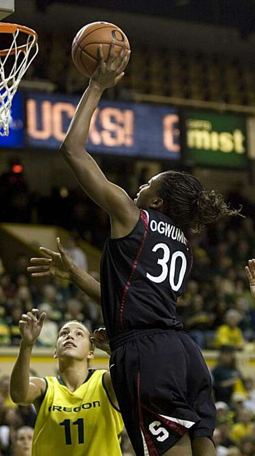 Stanford forward Nnemkadi Ogwumike, right, shoots over Oregon forward Amanda Johnson during the first half or an NCAA college basketball game in Eugene, Ore., Saturday, Jan. 23, 2010. Photo: Don Ryan, AP