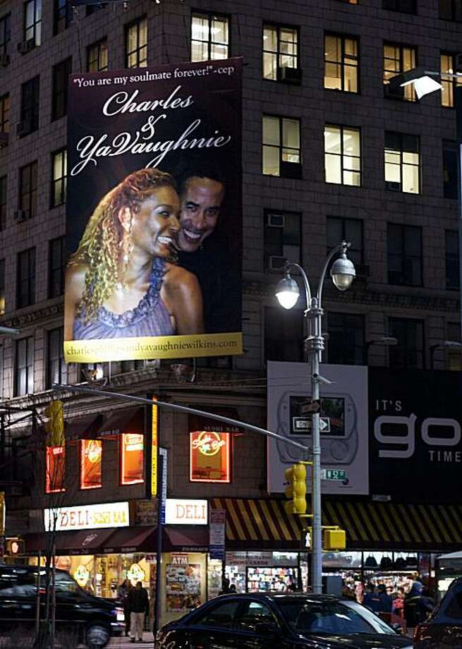 This undated photo provided by Jen Gallardo shows a billboard on the corner of 52nd St. and Broadway in New York featuring a photo of Charles Phillips and YaVaughnie Wilkins. Phillips, a co-president of software maker Oracle, acknowledges he had an affair with a woman he was shown snuggling with on billboards in New York, Atlanta and San Francisco. (AP Photo/www.jengallardo.com)  MANDATORY CREDIT   NO SALES Photo: Jen Gallardo, AP