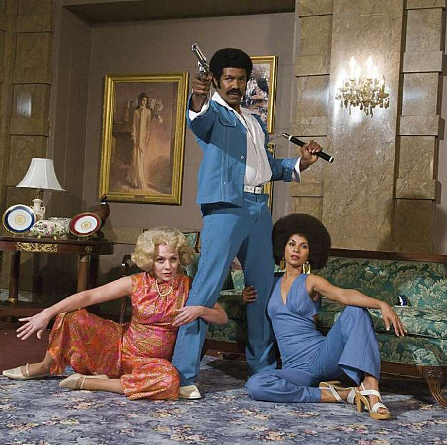 "Michael Jai White stars as ""Black Dynamite,"" a film by Scott Sanders. At left is Nicole Sullivan, at right is Sally Richardson-Whitfield. Photo: ARS Nova"