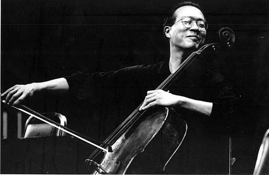 2002, Yo-Yo Ma, SRP:  Cellist Yo-Yo Ma (pictured) brought his Silk Road Project to Cal Performances in April 2002 for a 10-day festival of concerts, conferences, master classes and education programs to explore the cross-pollination of ideas, cultures, music, and art that occurred along the ancient Silk RoadÑa vast network of trade routes that were active from the first millennium B.C. to the middle of the second millennium A.D.  The sole university-based presenter in the Silk Road Project's inaugural year, Cal Performances commissioned a new work for the occasion from Mark Morris entitled Kolam, that featured the Mark Morris Dance Group and live accompaniment by Yo-Yo Ma (cello), Zakir Hussain (tabla), Ethan Iverson (piano), and Ben Street (bass) (Photo by Peter DaSilva).   Ran on: 01-02-2006 Mickey Rooney, at 14, as Puck in Max Reinhardt's &quo;A Midsummer Night's Dream&quo; in 1934; above, a 1910 postcard of the Greek Theatre. Photo: Peter DaSilva