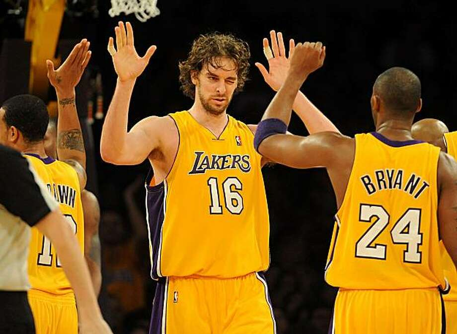 LOS ANGELES, CA - JANUARY 18:  Pau Gasol #16 and Kobe Bryant #24 of the Los Angeles Lakers celebrate after a play in the fourth quarter during the game against the Orlando Magic on January 18, 2010 at Staples Center in Los Angeles, California. Photo: Harry How, Getty Images