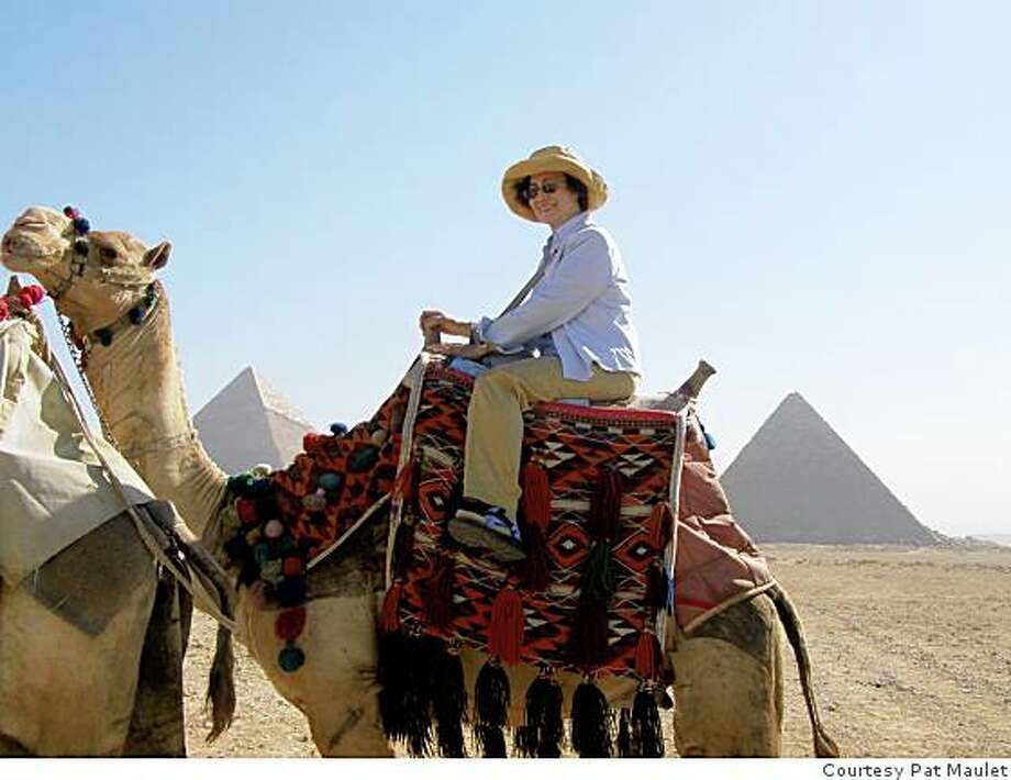 justback Cairo, EgyptPat Maulet, OaklandEmail: pmaul@sbcglobal.netDaytime phone number: 510 562 3683Just back from: Cairo, EgyptI went because: A return trip after 39 years and to complete a journey to the temples at Abu Simbel on the Nile River.Don't miss: A camel ride amidst the Pyramids and visiting the temples at Abu Simbel which were saved from being flooded by the Nile after the Aswan Dam was builtDon't bother: Bringing travelers checks.  They are difficult to cash and your ATM card and credit card are more useful and more readily accepted.Coolest souvenir: A gold cartouche (pendant) that I had made, spelling out my family name in hieroglyphics.  It's truly a one of a kind.Worth a splurge: A 3-day cruise on Lake Nasser to see view Abu Simbel from the lake and to visit some temples not normally visited on Nile River cruises.I wish I'd packed: More U.S. cash currency.  It's welcome at many places throughout Egypt and often easier and more economical to use than exchanging currency.Other comments: Egypt was fascinating and worth the long plane flight, but  it's also worth the extra time and money to take an extension to Petra, Jordan.Details of attached photo (if sent): Pat Maulet having a camel ride at the Pyramids of Giza near Cairo, Egypt.Attached photo (if sent):#attachedPhoto Photo: None, Courtesy Pat Maulet