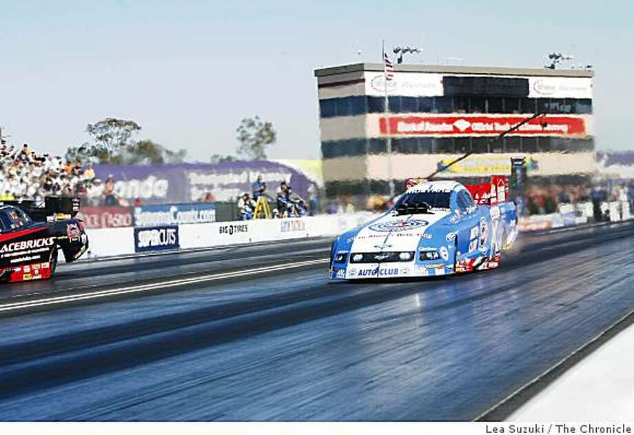 Robert Hight in the Auto Club Ford Mustang (right) won the Funny Car final against Gary Densham in the Racebricks Chevy Impala SS (left) at the the FRAM-Autolite Nationals at Infineon Raceway in Sonoma, Calif. on Sunday, July 27, 2008.Photo By Lea Suzuki/ The Chronicle Photo: Lea Suzuki, The Chronicle