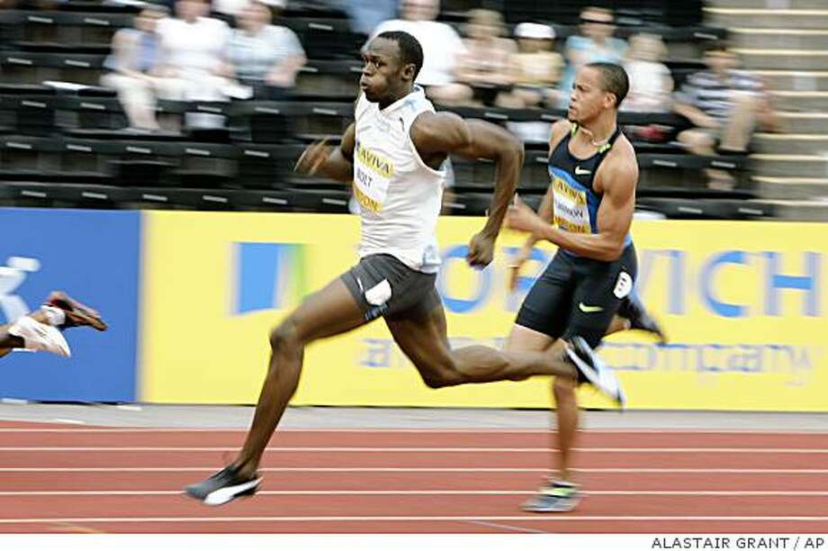 Usain Bolt of Jamaica, left, and Wallace Spearmon of U.S., right, compete in the men's 200m during the Aviva London Athletics Grand Prix at Crystal Palace, London, Saturday July 26, 2008. (AP Photo/Alastair Grant) Photo: ALASTAIR GRANT, AP