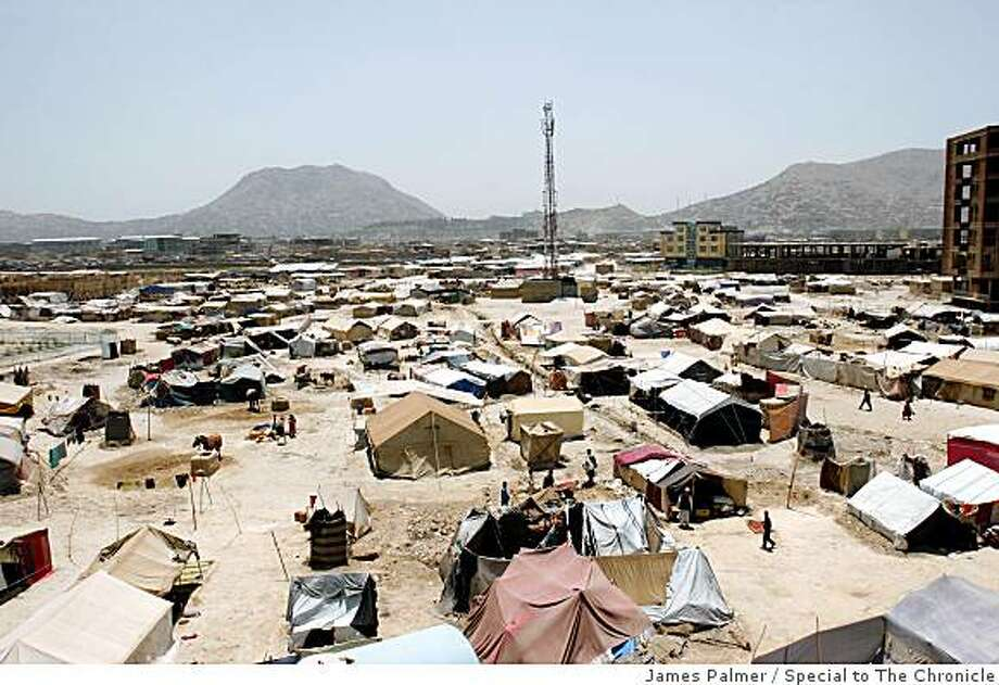 The Chami-Babrak displacement camp on the outskirts of Kabul, Afghanistan, on July 10, 2008. The camp now houses former Afghan refugees who have returned mostly from Pakistan.  The Chami-Babrak displacement camp in Kabul, Afghanistan, on July 10, 2008, where former Afghan refugees who have returned to the country now live.    Since 2002 the UNHCR has repatriated more than 5 million Afghans ? the largest such operation in the organizations 58-year history. But many of these former refugees, battered by multiple conflicts and years of harsh living conditions in exile, have returned to their country in recent years only to find themselves homelessness and unemployed.  JAMES PALMER / FOR THE CHRONICLE Photo: James Palmer, Special To The Chronicle