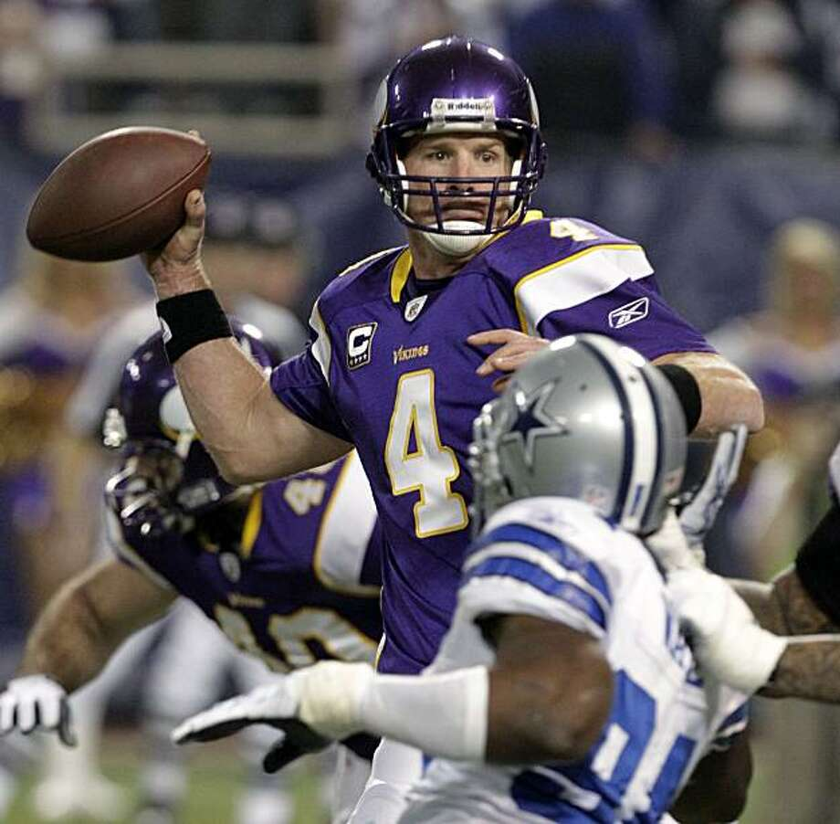 Minnesota Vikings' Brett Favre (4) drops back to pass with Dallas Cowboys' L.P. LaDouceur applying pressure during the first half of an NFL divisional playoff football game Sunday, Jan. 17, 2010, in Minneapolis. Photo: Paul Sancya, AP