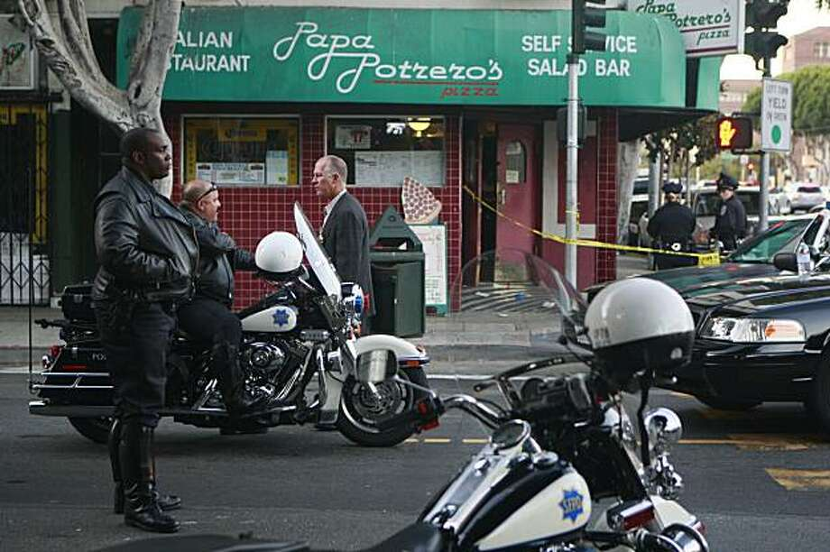 Officials work on 24th Street at Portrero Avenue outside of Papa Potrero's Pizza, the scene of a multiple shooting in San Francisco, Calif. on Sunday, September 20, 2009. Photo: Lea Suzuki, The Chronicle