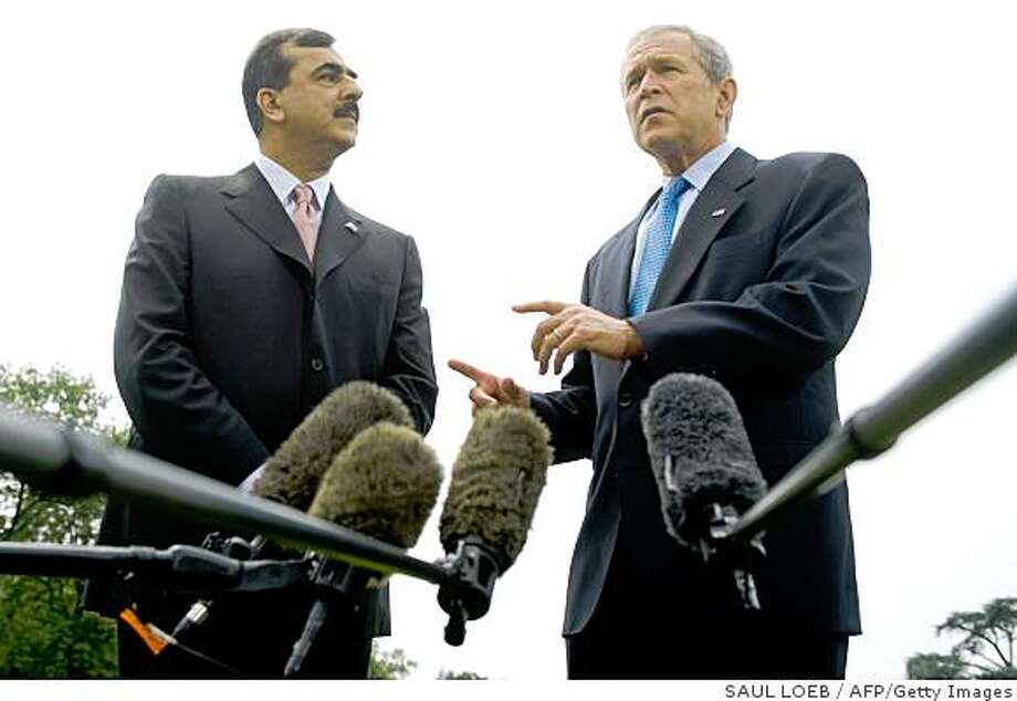 "US President George W. Bush (R) speaks with Pakistan's Prime Minister Yousuf Raza Gilani on the South Lawn of the White House, after meeting in the Oval Office, in Washington, DC, on July 28, 2008. Pakistani Prime Minister Gilani said Monday following talks with US President George W. Bush that his country was committed to the fight against ""extremists and terrorists."" AFP PHOTO/SAUL LOEB (Photo credit should read SAUL LOEB/AFP/Getty Images) Photo: SAUL LOEB, AFP/Getty Images"
