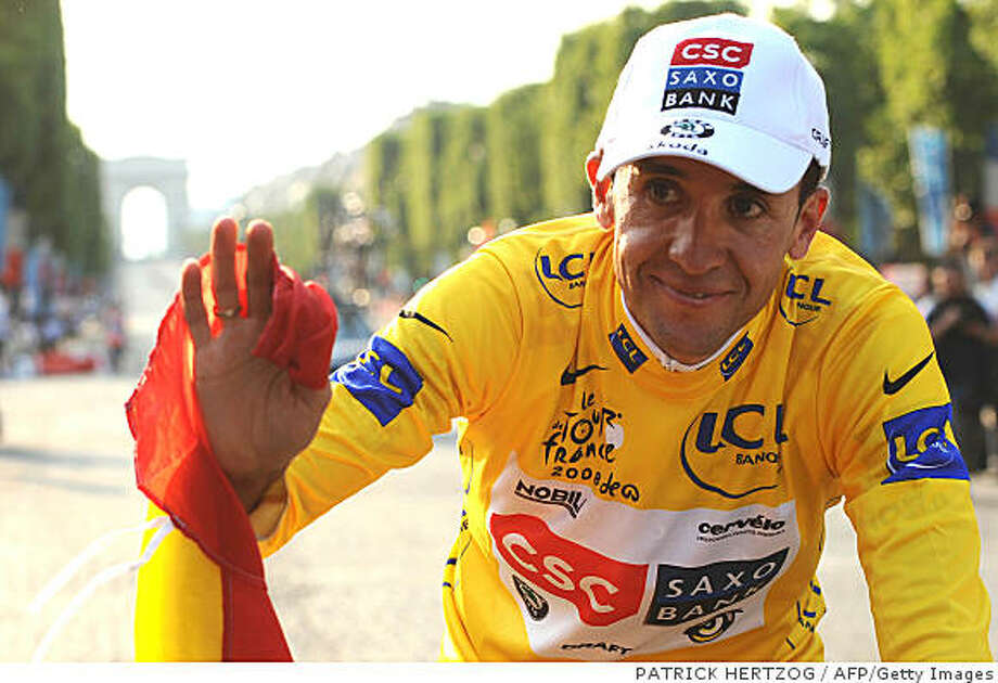 2008 Tour de France winner Spanish co-team leader Carlos Sastre (CSC/Den) waves his Spanish flag on the Champs-Elysees Avenue, on July 27, 2008, at the end of the 143 km twenty-first and last stage of the 2008 Tour de France run between Etampes and Paris Champs-Elysees. Belgian Gert Steegmans (Quick Step/Bel) won ahead of German Gerald Ciolek (Columbia -ex-High Road/US) and best sprinter green jersey Spanish Oscar Freire (Rabobank/Ned).  AFP PHOTO PATRICK HERTZOG (Photo credit should read PATRICK HERTZOG/AFP/Getty Images) Photo: PATRICK HERTZOG, AFP/Getty Images
