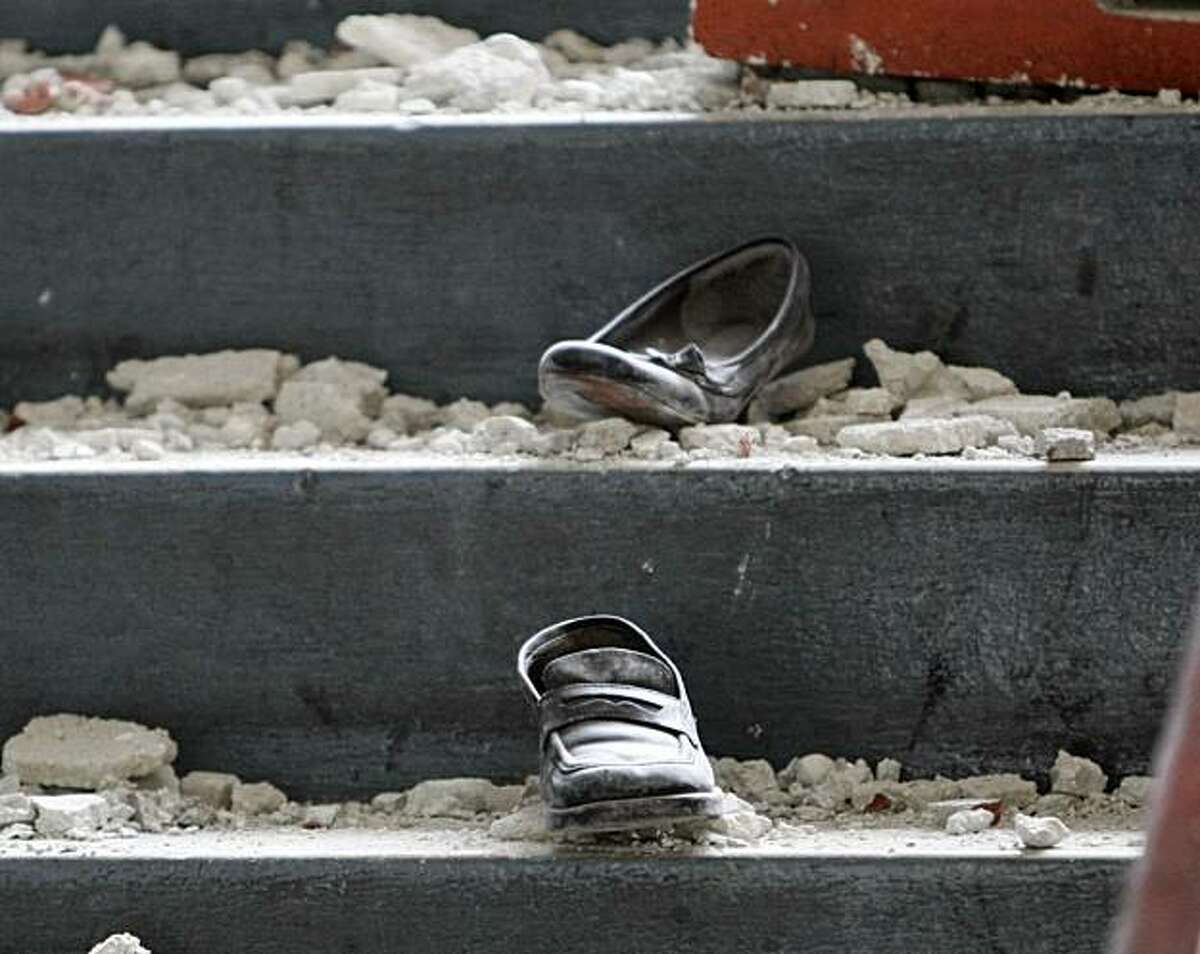 011910 PORT-AU-PRINCE, HAITI ?' Shoes lost on the stairs sit in rubble at the St. John the Evangelist primary school. Schools of all types all over Port-au-Prince were destroyed in the earthquake, leading to the problem of educating the next generation of Haitians. (Lannis Waters/The Palm Beach Post)