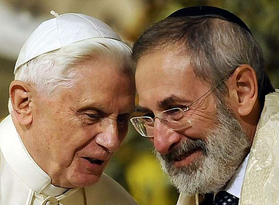 Pope Benedict XVI (L) chats with chief Rabbi Riccardo Di Segni in Rome's main Synagogue on January 17, 2010. Pope Benedict XVI paid homage to more than 1,000 Roman Jews deported to Nazi death camps as he started a landmark visit to the synagogue. Photo: Filippo Monteforte, AFP/Getty Images