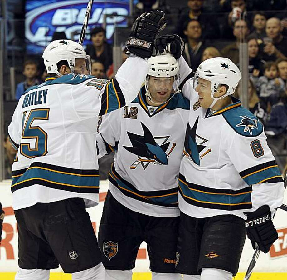 San Jose Sharks left wing Dany Heatley, left, and center Joe Pavelski, right, congratulate center Patrick Marleau after Marleau scored a goal against the Los Angeles Kings in the first period of an NHL hockey game in Los Angeles, Tuesday, Jan. 19, 2010. Photo: Lori Shepler, AP