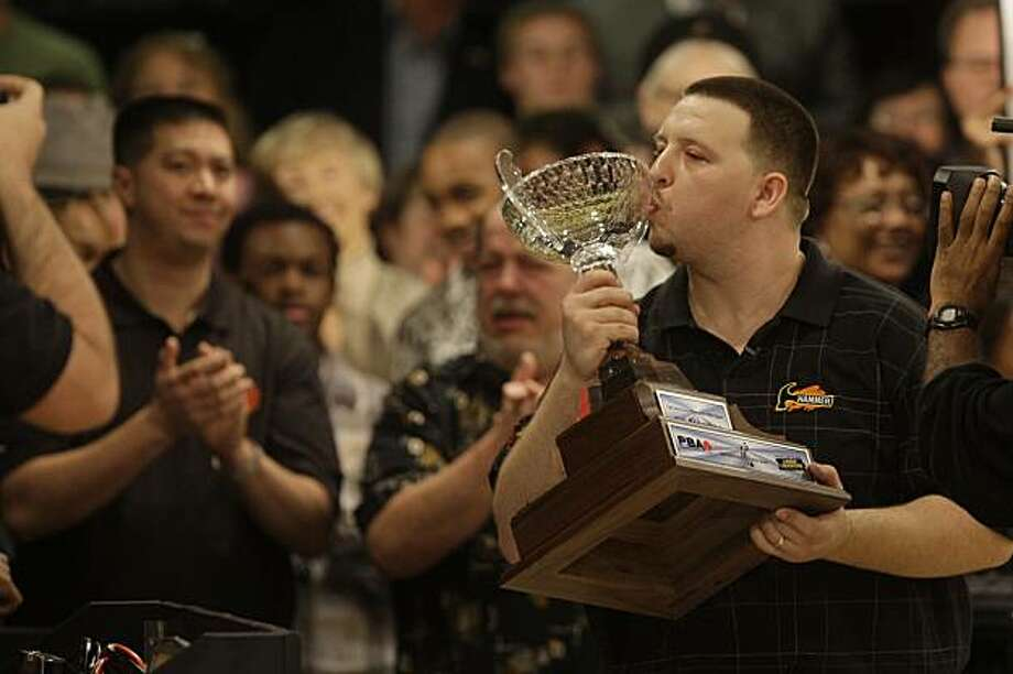 Anthony LaCaze kisses his trophy after winning the  men's finals of the Earl Anthony Memorial Classic at Earl Anthony's Dublin Bowl in Dublin, Calif. on Sunday, January 17, 2010. Photo: Lea Suzuki, The Chronicle