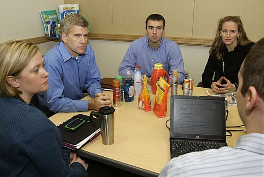In this photo made Friday, Jan. 8, 2010, Procter & Gamble Co. employees, from left, Mandy Treeby, Kirk Perry, vice president for North America, Dave Brenner, and Suzanne Watson, listen to John McFarland, at a meeting on online retail sale in Cincinnati. P&G is ready to begin testing an online retail site that will enable shoppers to buy from the household portfolio of P&G. Photo: Al Behrman, AP
