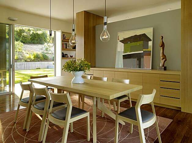 Family 39 s new home fits the bill casual warm sfgate for Casual dining room light fixtures