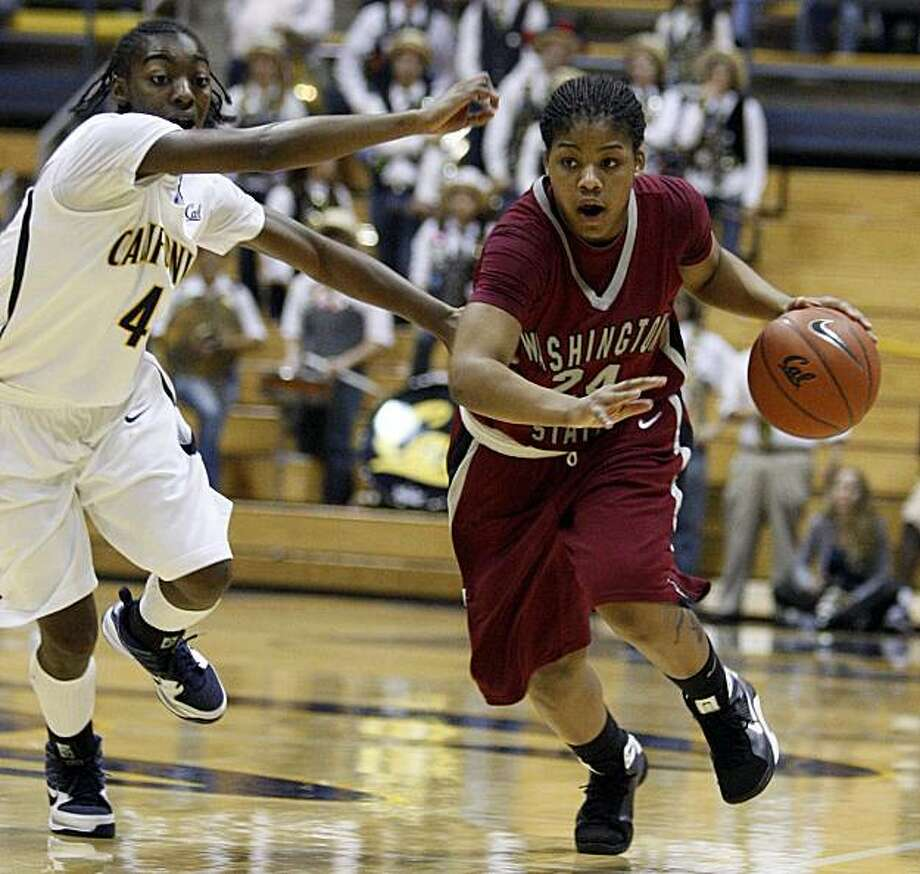 Washington State's KiKi Moore, right, drives past California's Eliza Pierre during the first half of an NCAA college basketball game Saturday, Jan. 16, 2010, in Berkeley, Calif. Photo: Ben Margot, AP