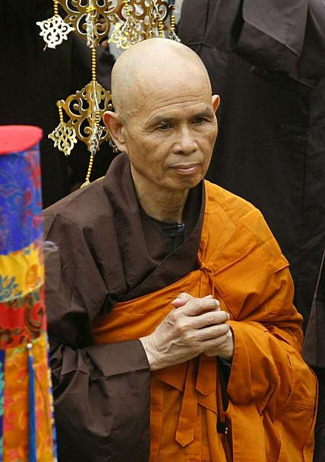 FILE - In this March 16, 2007 file photo, Thich Nhat Hanh, a Vietnamese-born Zen master who popularized Buddhism in the West, arrives for a Great Chanting Ceremony at Vinh Nghiem Pagoda in Ho Chi Minh City, southern Vietnam. Followers of the famous Buddhist monk have abandoned the temple in southern Vietnam where they had sought sanctuary and are on the run from police, who have been pressuring them for months to break up their monastic community and return to their home villages, a spokeswoman for the monks and nuns said by telephone Thursday, Dec. 31, 2009.  (AP Photo/File) Photo: AP
