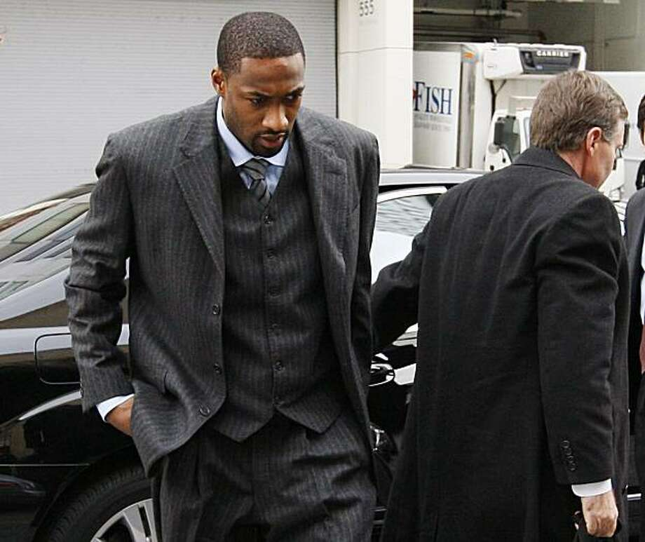 Washington Wizards' Gilbert Arenas, left, arrives with attorney Kenneth Wainstein, right, in Superior Court in Washington, Friday, Jan. 15, 2010.  Arenas is to appear in court to answer a felony charge of carrying a pistol without a license, which carriesa maximum penalty of five years in prison. Photo: Ann Heisenfelt, AP