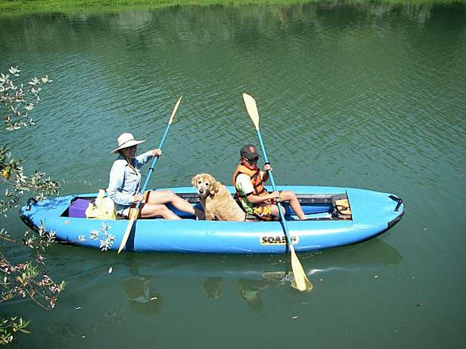 People enjoy the Russian River in an inflatable canoe from Russian River Adventures, which is dog friendly. Photo: Russian River Adventures