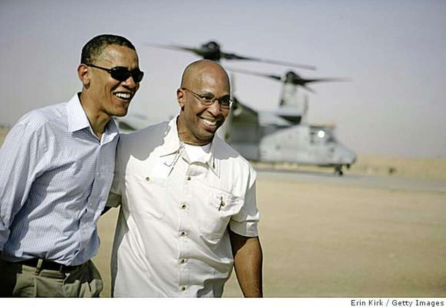 In this handout photograph released by the US military, US Democratic presidential candidate Barack Obama (L) arrives with a Secret Service member on a V-22 Osprey aircraft in Ramadi, 100 kms west of Baghdad, on July 22, 2008. White House hopeful Barack Obama today ended his high-profile tour to Iraq by sharing a common vision with Prime Minister Nuri al-Maliki of withdrawing the US forces from the country by 2010. AFP PHOTO / HO / ERIN A. KIRK   ==RESTRICTED TO EDITORIAL USE== (Photo credit should read ERIN KIRK/AFP/Getty Images) Photo: Erin Kirk, Getty Images