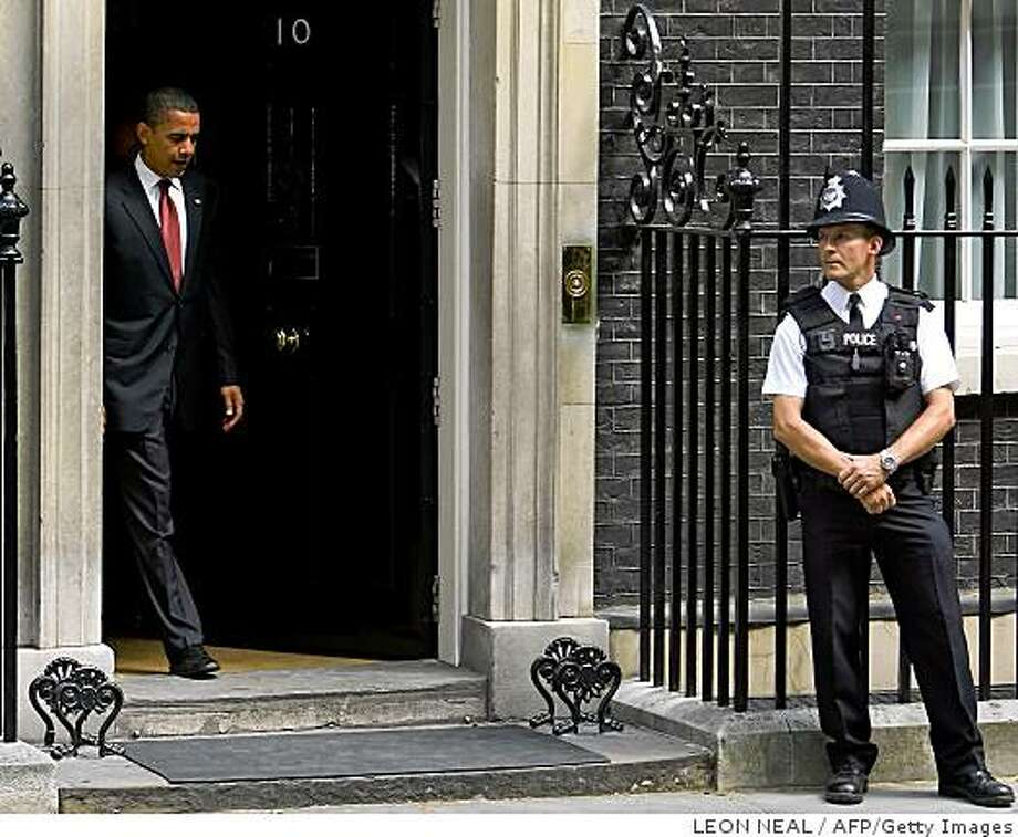 US Democratic presidential candidate Barack Obama leaves Number 10 Downing Street in London following a meeting with British Prime Minister Gordon Brown, on July 26, 2008. Obama met Brown on the last stop of an international tour with the focus on key foreign policy issues facing both countries, particularly Iraq and Afghanistan. AFP PHOTO/LEON NEAL (Photo credit should read Leon Neal/AFP/Getty Images) Photo: LEON NEAL, AFP/Getty Images