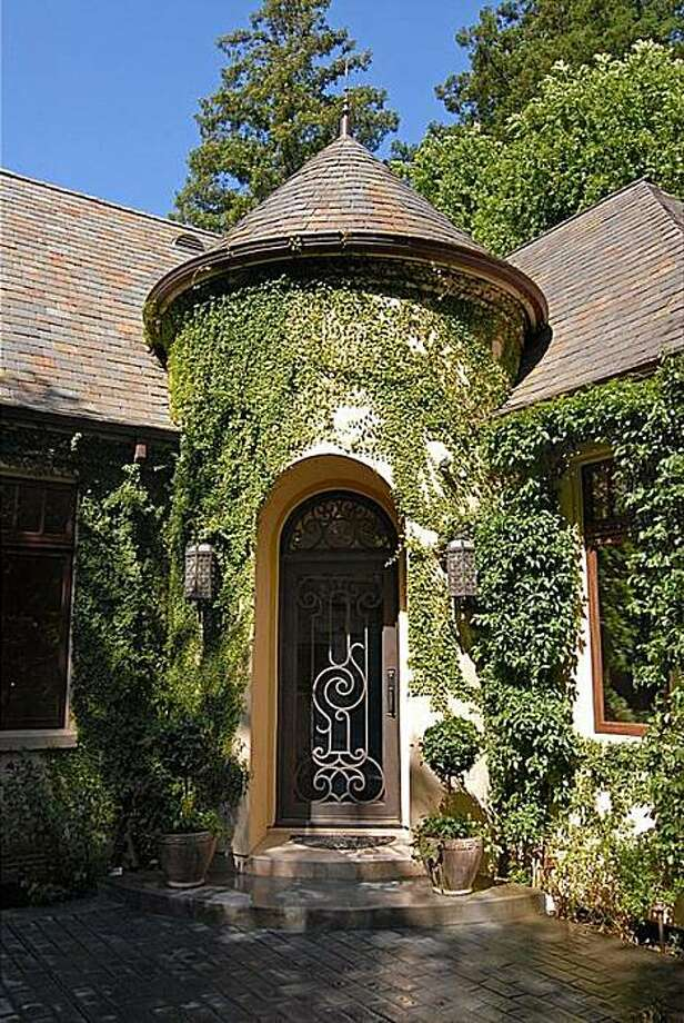 The turret entrance with a custom iron gate door at 1125 Jackling Dr. in Hillsborough. Photo: Ian Coleman, Bs