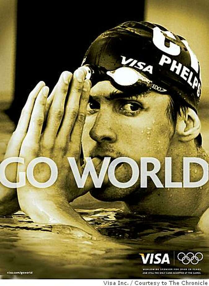 """Part of Visa's U.S. ad campaign includes a series of """"Go World"""" ads that evokes memories of inspiring moments in Olympics history. This ad shows 2004 Summer Olympics athlete Michael Phelps. Photo Courtesy of Visa Inc. Photo: Visa Inc., Courtesy To The Chronicle"""