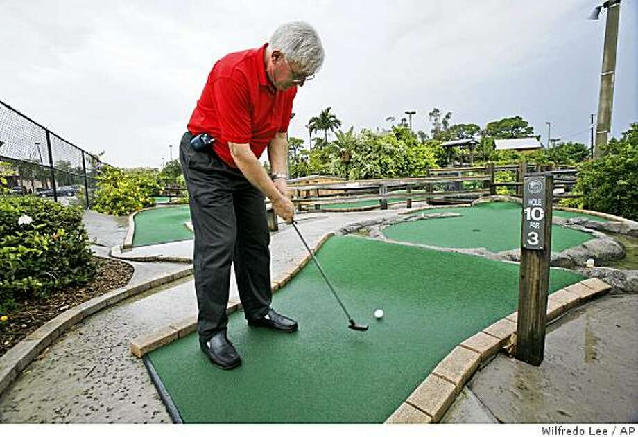 Jerry Doser, owner of Adventure Mini Golf demonstrates a hole on the course in Lake Worth, Fla., Friday, July 4, 2008. Miniature golf courses are one of hundreds of areas that would be affected by proposed regulatory changes under the Americans with Disabilities Act, a milestone civil rights law passed in 1990 that prohibits discrimination on the basis of disability. (AP Photo/Wilfredo Lee) Photo: Wilfredo Lee, AP