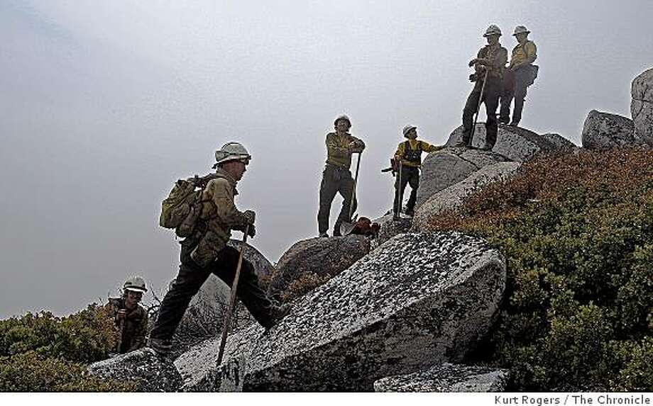 Members of the Firestorm crew stand on the side of Shasta Bally at 6000 feet  in the smoke-filled air in Whiskeytown, Calif., on Friday July 18, 2008. Photo by Kurt Rogers / The Chronicle Photo: Kurt Rogers, The Chronicle
