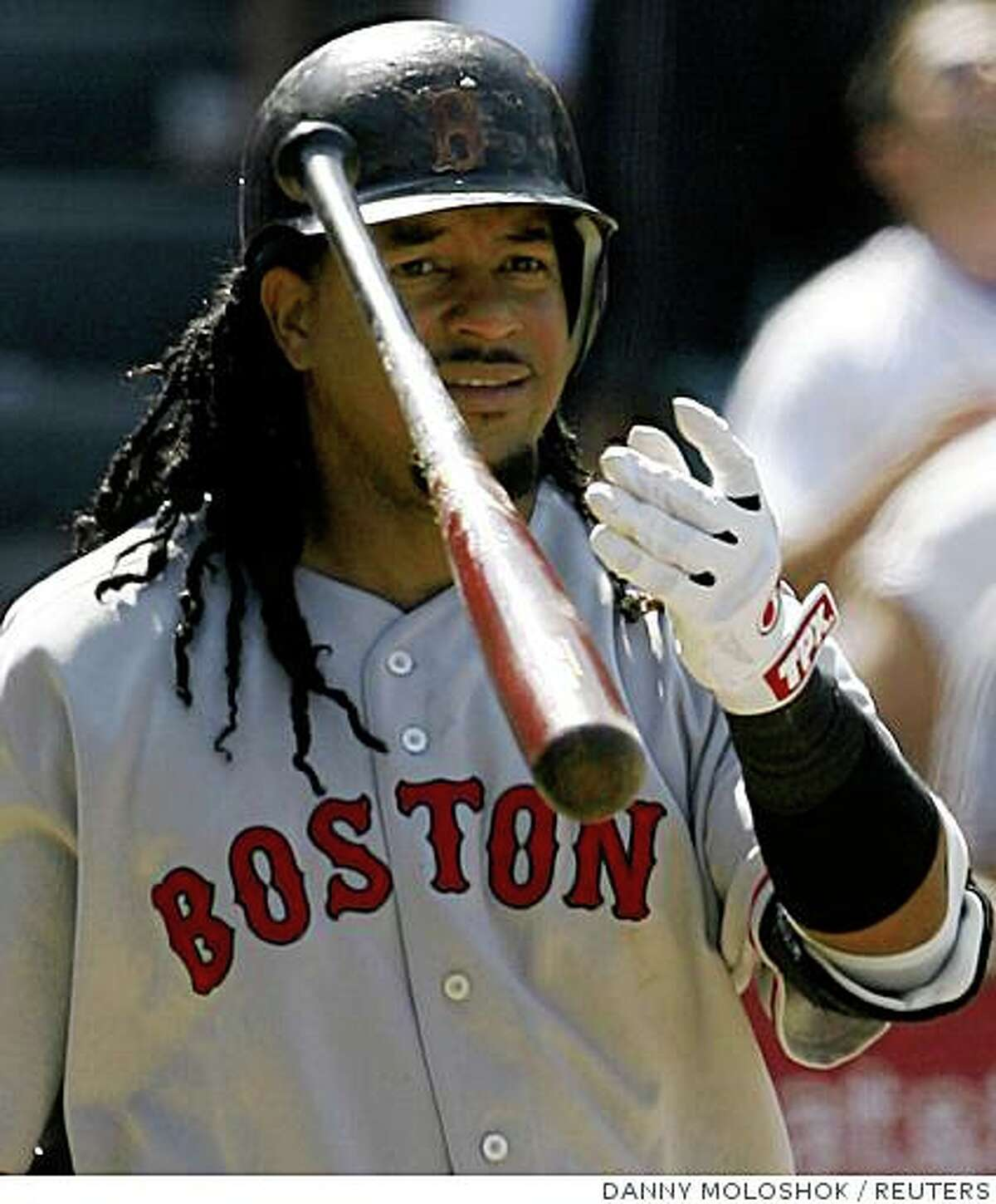 Boston Red Sox Manny Ramirez tosses his bat after popping up for an out against the Los Angeles Angels during the ninth inning of their MLB American League baseball game in Anaheim, California July 19, 2008. REUTERS/Danny Moloshok (UNITED STATES)