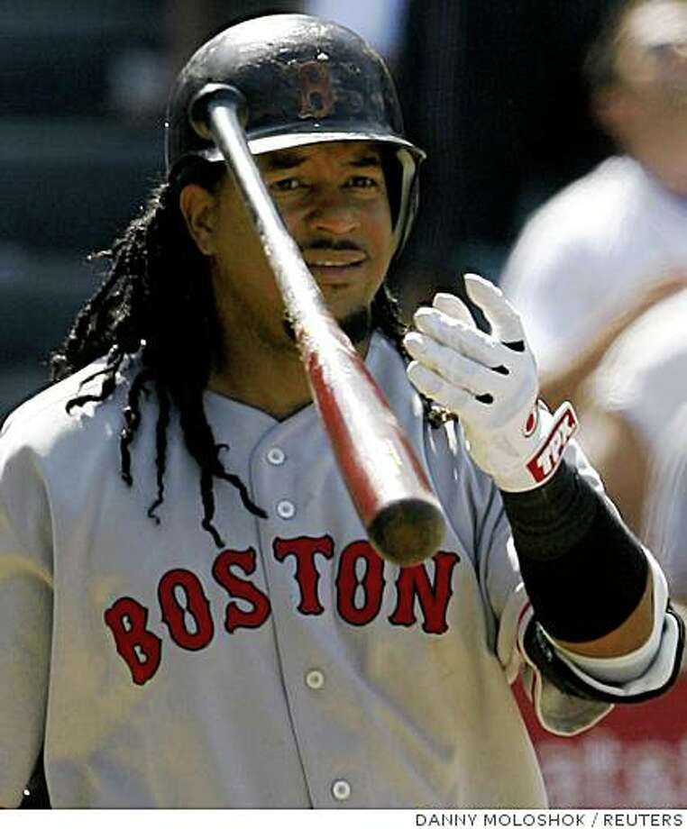 Boston Red Sox Manny Ramirez tosses his bat after popping up for an out against the Los Angeles Angels during the ninth inning of their MLB American League baseball game in Anaheim, California July 19, 2008. REUTERS/Danny Moloshok (UNITED STATES) Photo: DANNY MOLOSHOK, REUTERS
