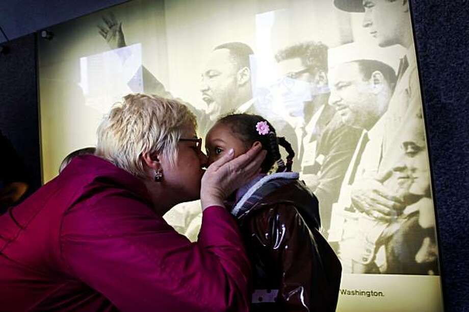 "Karen Williams gives her daughter Kayla a kiss after answering her  questions about Kings' 'I Have A Dream"" speech at the Yerba Buena Gardens, Monday Jan. 18, 2010, in San Francisco, Calif. Photo: Lacy Atkins, The Chronicle"