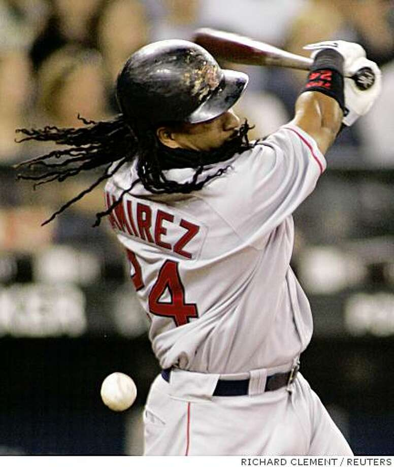 Boston Red Sox' Manny Ramirez hits a foul ball during the ninth inning of their MLB American League baseball game against the Seattle Mariners in Seattle July 21, 2008. REUTERS/Richard Clement (UNITED STATES) Photo: RICHARD CLEMENT, REUTERS