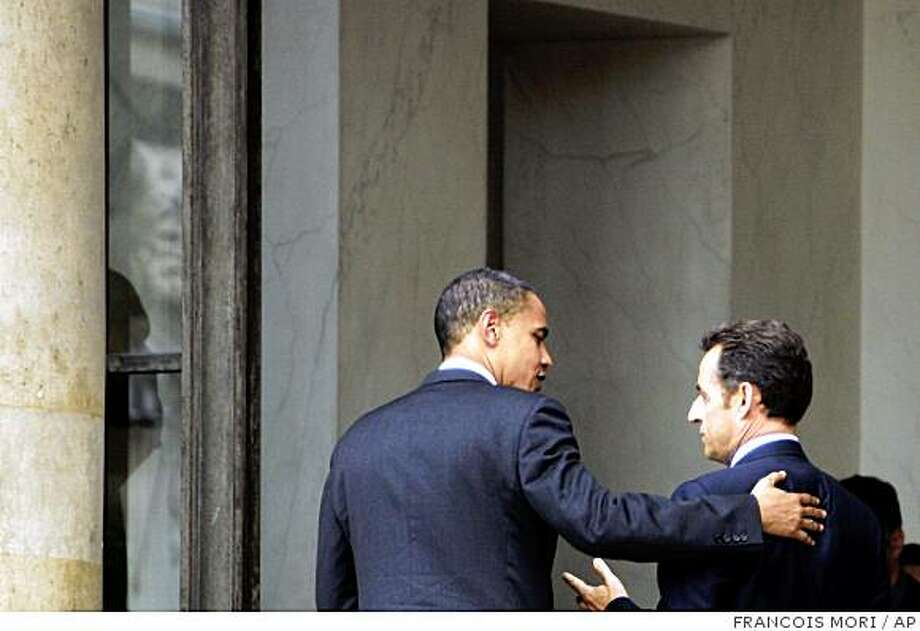 U.S. Democratic presidential contender Sen. Barack Obama, left, is welcomed by France's President Nicolas Sarkozy, right, upon his arrival at the Elysee Palace in Paris, Friday, July 25, 2008. (AP Photo/Francois Mori) Photo: FRANCOIS MORI, AP