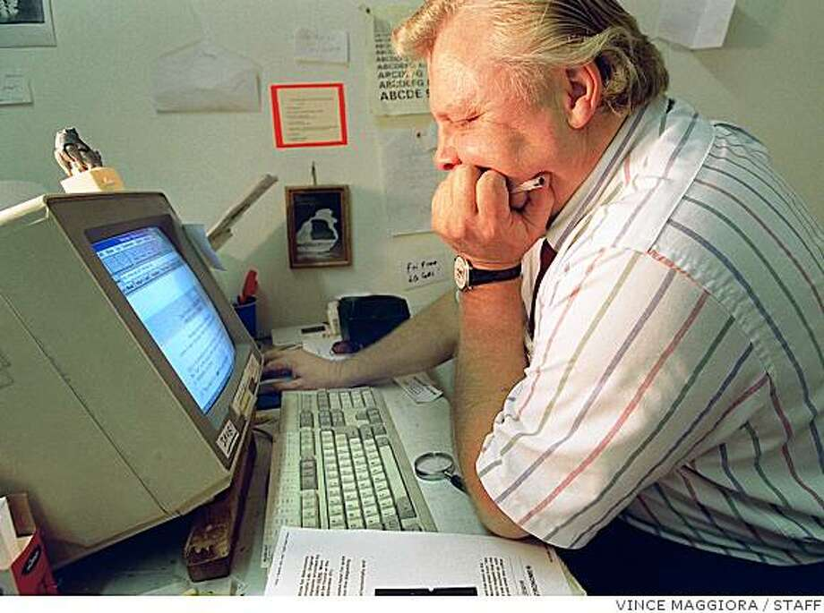 CULT 2/C/27MAR97/CD/VM = Erik Beckjord looking for info on Hale-Bopp and a planet sized spacecraft on the internet. in his office. Vince Maggiora Photo: VINCE MAGGIORA, STAFF