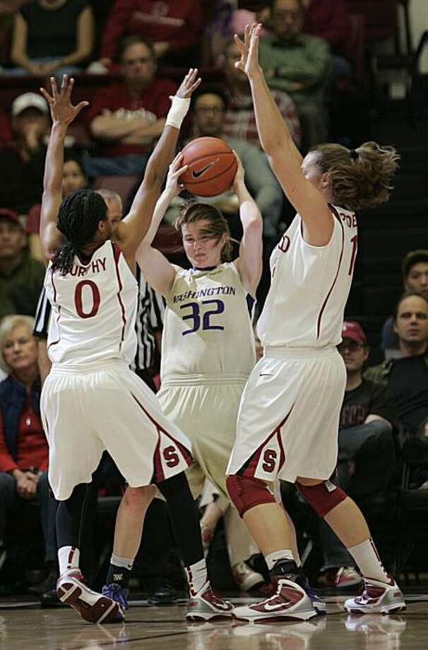 Washington guard Sami Whitcomb is covered closely by Stanford guard JJ Hones and Stanford forward Kayla Pedersen, left, during the first half Saturday. Photo: Paul Sakuma, AP