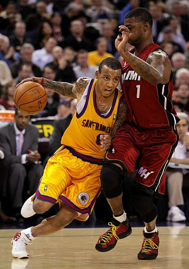 Monta Ellis drives to the basket past the Heats' Dorrell Wright in the second half. The Golden State Warriors played the Miami Heat at Oakland-Alameda County Coliseum, in Oakland, Calif.,  on Wednesday, January 13, 2010. Photo: Carlos Avila Gonzalez, The Chronicle