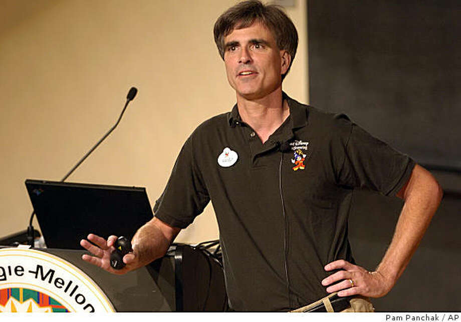 "**FILE**Randy Pausch talks to the standing room only crowd at Carnegie Mellon University's McConomy auditorium in Pittsburgh  in this  September 18, 2007, file photo. The computer scientist whose ""last lecture"" about facing terminal cancer became an Internet sensation and a best-selling book,died early Friday, July 25, 2008, at his home in Virginia. He was 47. This popular last lecture  garnered international attention and was viewed by millions on the Internet.  .   (AP Photo/Pam Panchak/Post-Gazette) Photo: Pam Panchak, AP"