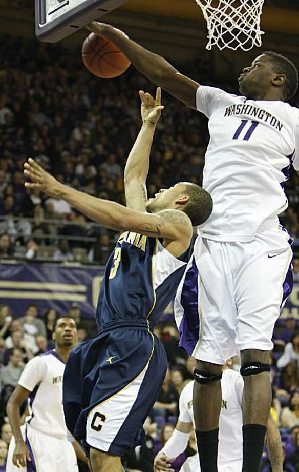 Washington's Matt Bryan-Amaning, top, knocks the ball from California's Jerome Randle, left, during the second half of a NCAA college basketball game in Seattle, on Saturday, Jan. 16, 2010. Washington defeated California 84-69. Photo: Kevin P. Casey, AP