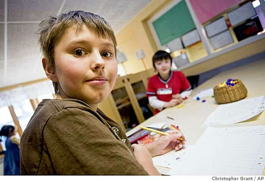 ** ADVANCE FOR SUNDAY, JULY 27 ** A student is shown working on an assignment at the Vittra school in Sollentuna, Sweden, on Wednesday April 30, 2008. It may sound out of place in Sweden, that paragon of taxpayer-funded cradle-to-grave welfare. But school choice has survived the critics and 16 years later it is spreading and attracting interest abroad. Since the change was introduced in 1992 by a center-right government that briefly replaced the long-governing Social Democrats, the numbers have shot up. In 1992, 1.7 percent of high schoolers and 1 percent of elementary schoolchildren were privately educated. Now the figures are 17 percent and 9 percent.  (AP Photo/Christopher Grant) Photo: Christopher Grant, AP